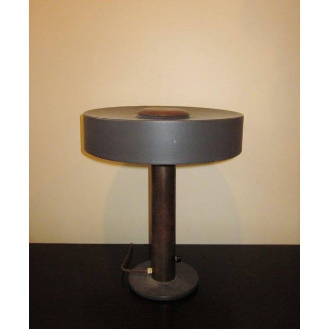 This is a vintage 1950s era Mid-Century Modern lamp that we have attributed to Louis Christiaan Kalff, the sought after...