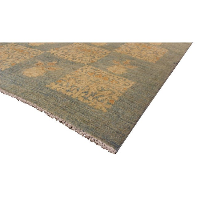 Fashionable handmade rug crafted by skilled artisans with trendy an elegant modern/transitional design with a soothing...