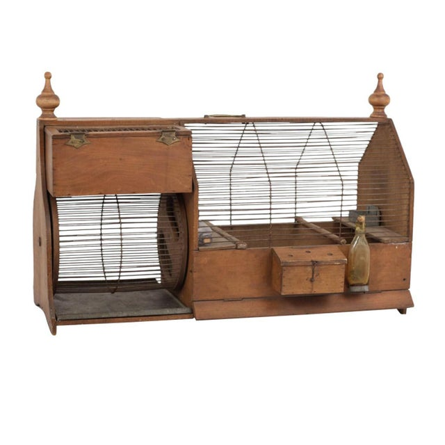 This rare 19th century squirrel cage is fascinating on a myriad of levels. The Victorian Gothic architecture, the...
