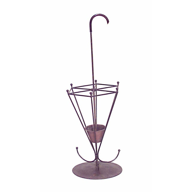 American Mission wrought iron umbrella shaped umbrella stand with round hammered base.
