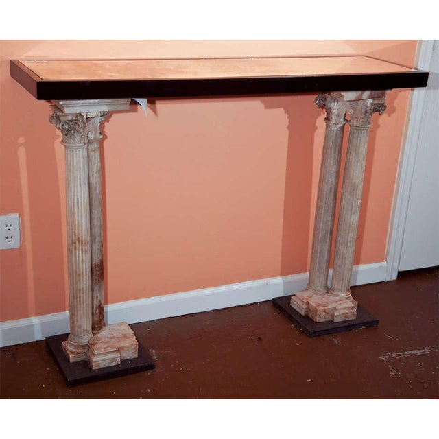 Neoclassical style console table, circa 1940s, ebonized top with smokey glass inset, supported by beautiful alabaster...