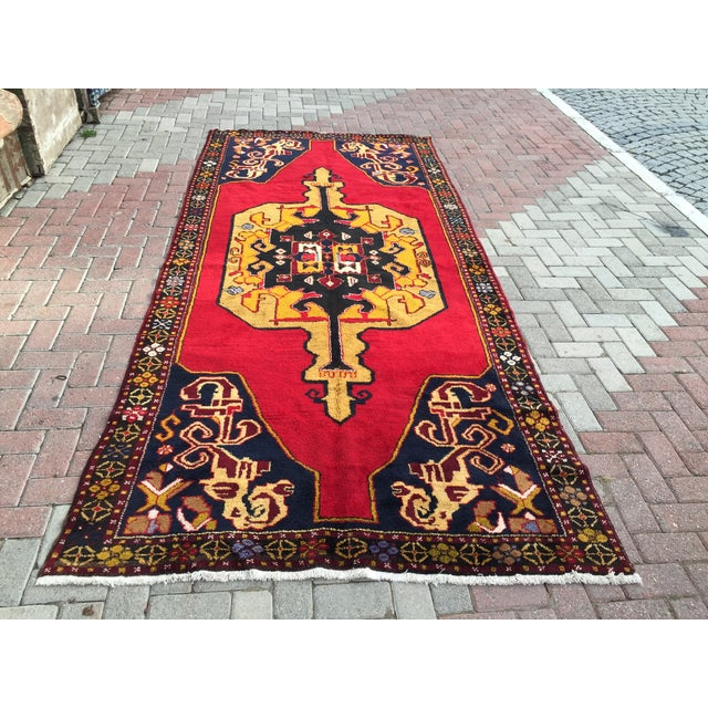 This gorgeous Hand knotted Vintage Anatolian area rug is approximately 40 years old in excellent vintage condition. The...