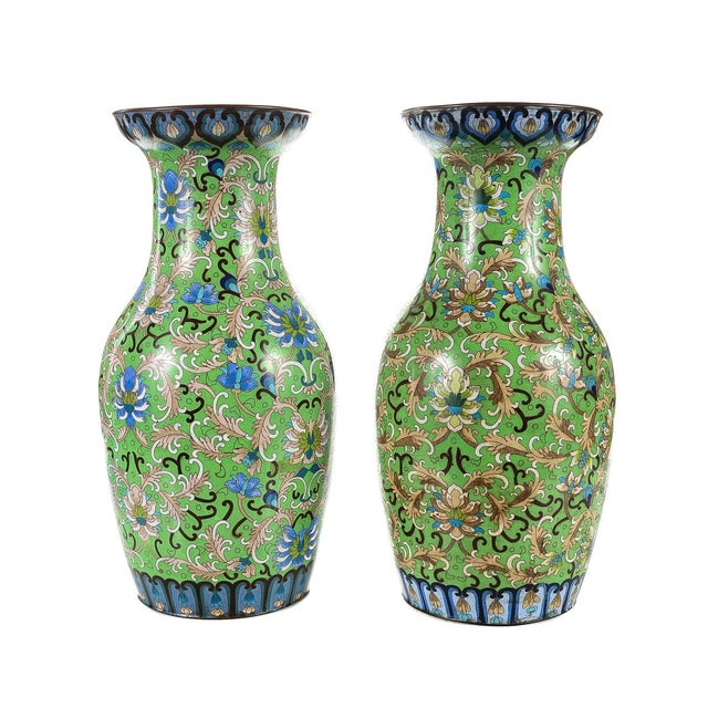 "A pair of antique 18"" Chinese green cloisonné vases with a filigree motif. Size 8 x 18""."