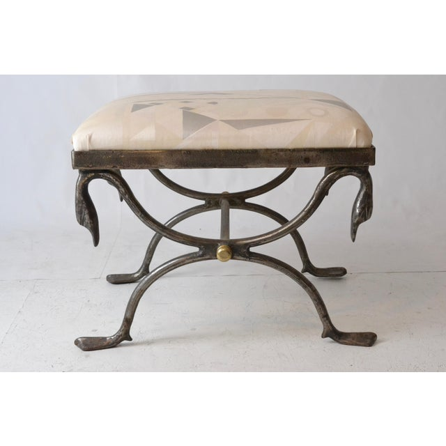 """Handsome, heavy steel bench with brass finial detail. Webbed """"swan"""" feet and bent neck swan decoration. Tight upholstered..."""