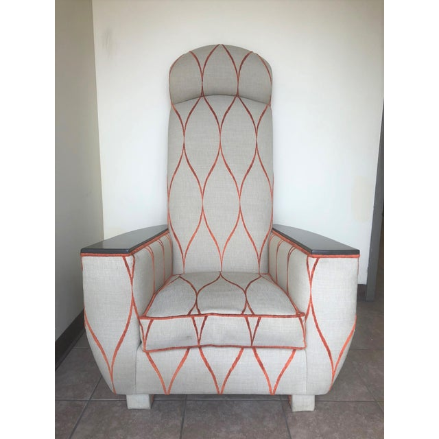 Decorative modern tall back lounge or armchair. The back of the chair is upholstered in orange velvet. Has solid wooden...