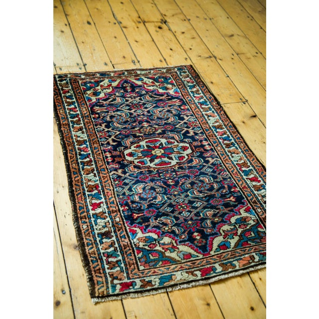 A vintage, 1950's Persian Lilihan with floral bouquets and meandering leaf border. Dark blue field with tremendous variety...