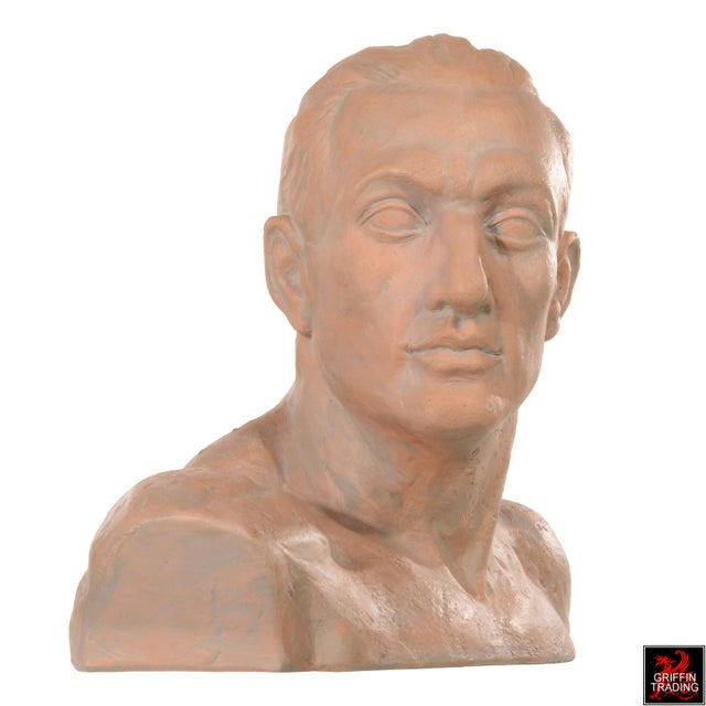 This handsome male terracotta bust has a rugged athletic appearance. Inspired by an early 20th century bust of man, this...