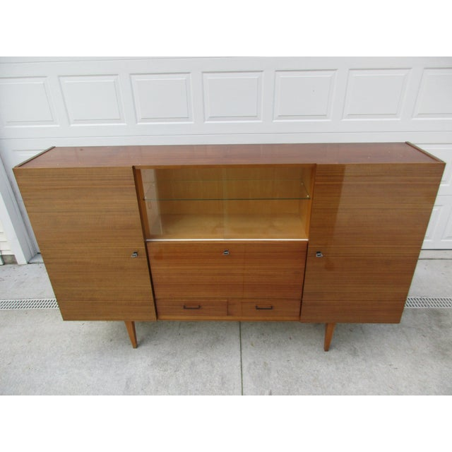 Here's an exception German bar cabinet or shrunk. It is made by Kubah Mobel and has a high-gloss finish. There are four...