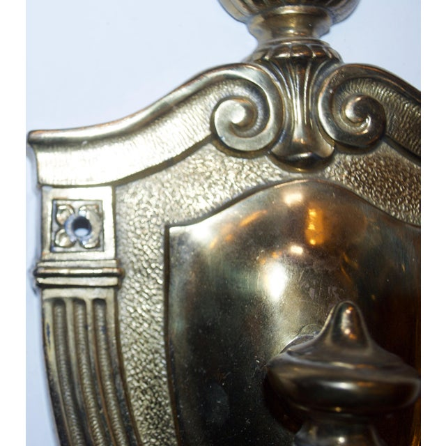 Classic pair of brass wall sconces. Excellent condition. This item, once sold, will be electrically reconditioned to...