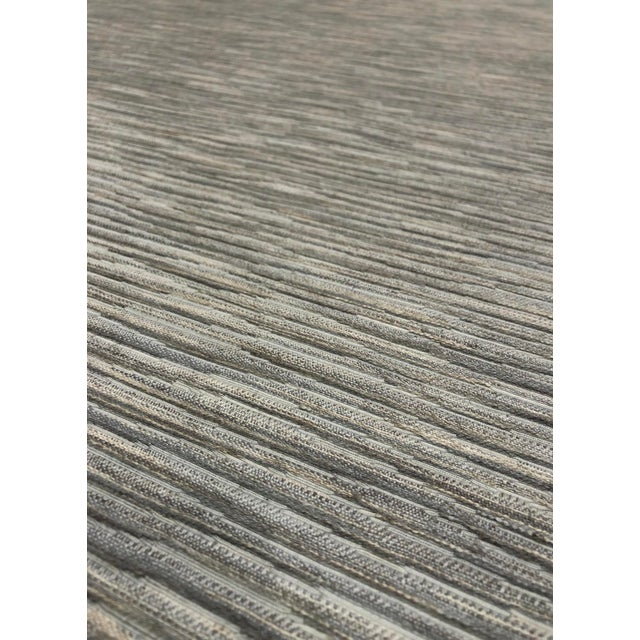 New Horizons - Birch is a classic but modern upholstery fabric from Kravet. It has an abstract linear pattern with a...