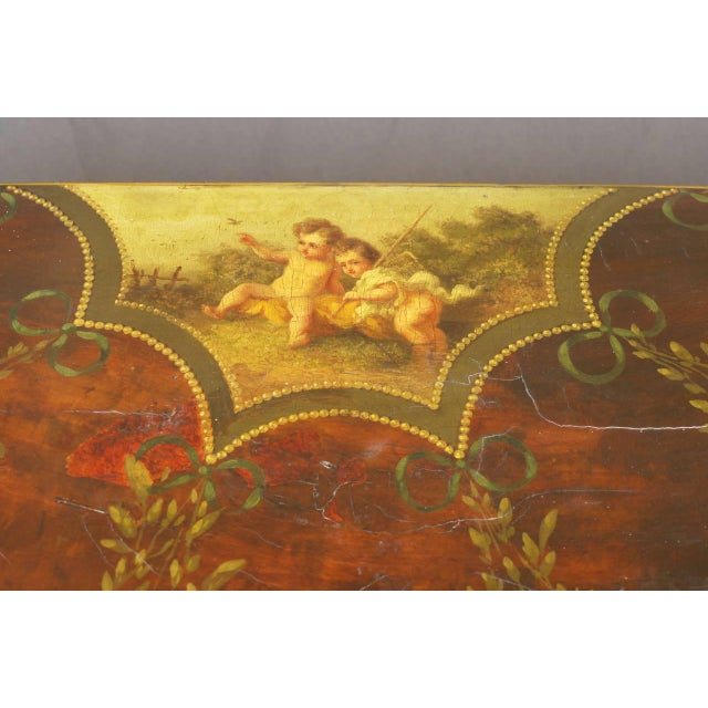A stunning Sheraton Period demilune card table with Angelica Kauffmann style painting and decorative floral swags over...