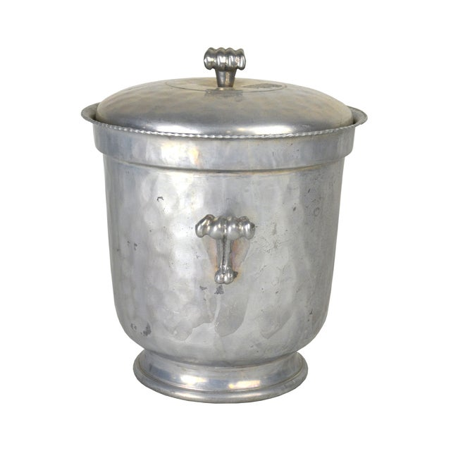 Offered is a stunning hammered aluminum ice bucket. This elegant piece is ideal for a classic regency style lounge area!...
