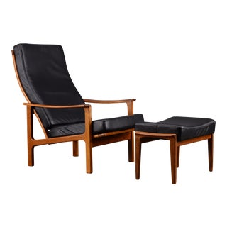 Mid Century Black Leather and Teak Broderna Anderssons Chair and Footstool For Sale