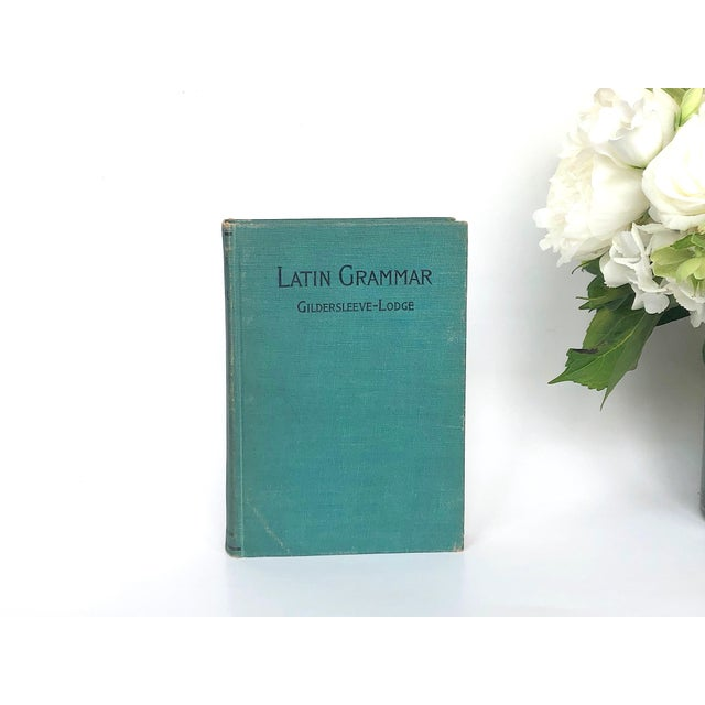 Add an intellectual touch to your home decor with this antique Latin grammar book. The vintage Latin textbook can be used...