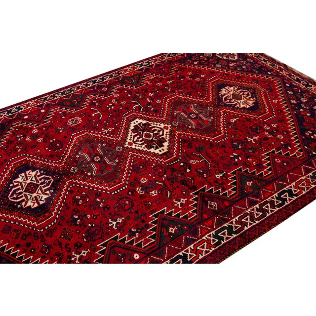 Vintage hand-knotted Persian Shiraz rug with a tribal motif. This piece has magnificent detailing and great colors. It...