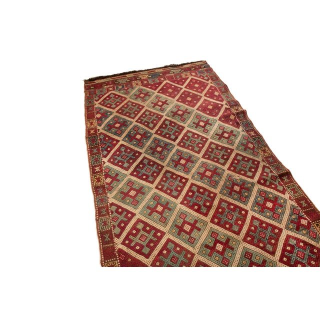 This kilim is stylish with its rich red field and pretty repetitive pattern. A beautiful diamond design comes alive in a...