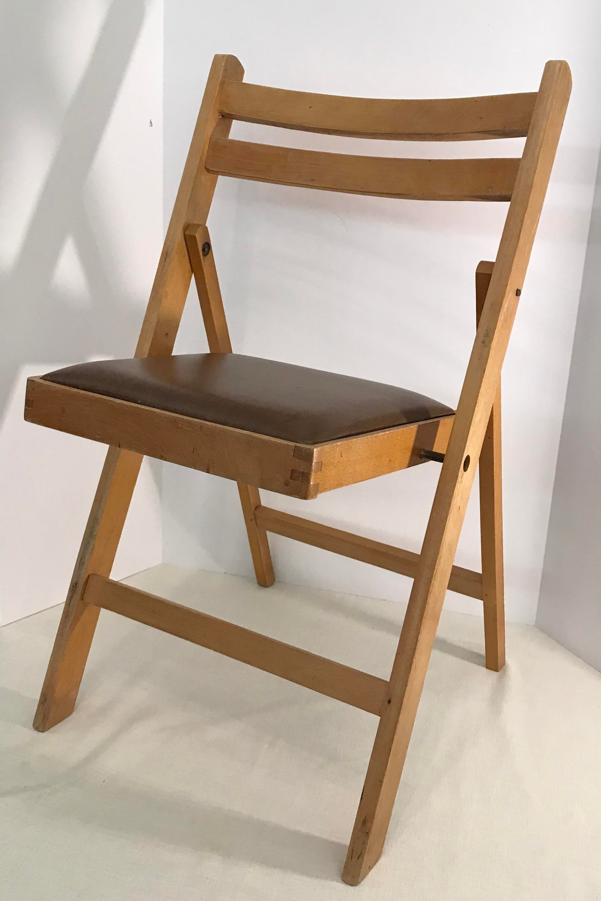 Nice vintage wooden folding chair with brown vinyl seat. The seat is marked on bottom  sc 1 st  Chairish & Vintage Wooden Folding Chair Made in Romania | Chairish
