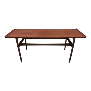 Jens Risom walnut and glass console table