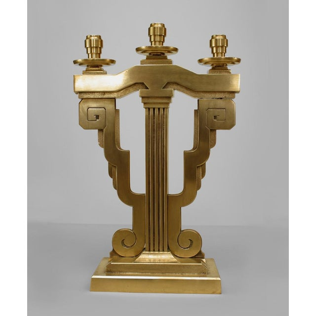 Pair of American Art Deco bronze 3 arm candelabra with scroll design sides and supported on a stepped rectangular base...