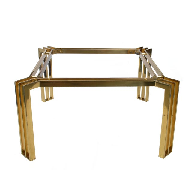 "Square Italian brass coffee table with brass spacers. Marked underneath: ""Made in Italy."" Note: no glass included."