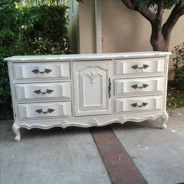A lovely, French Provincial buffet dresser. Painted in Annie Sloan Old White. This is distressed with a hint of blue...