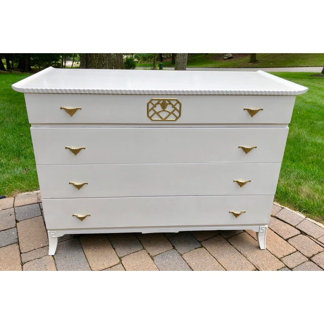 White Lacquered Mid Century Modern Asian Form Chinoiserie Style 4 Drawer Chest. Brass Fixtures and Hardware. Greek Key on...