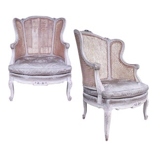 Large Antique Louis XVI Style Painted and Caned Wing Chairs - A Pair For Sale