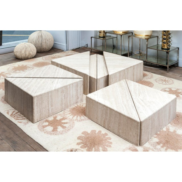 A set of 8 triangular elements forming four squares. Travertine It's possible to combine these elements in many ways to...