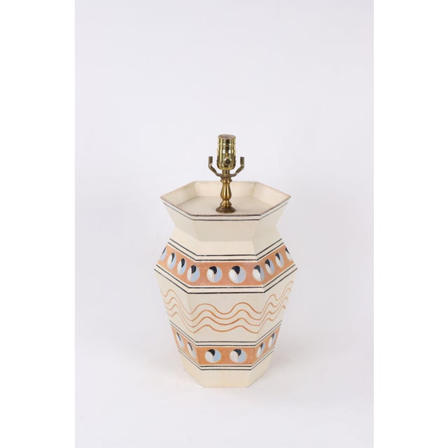 This hand painted hexagonal urn features underglaze details such as rusty waves and two major bands running horizontally...