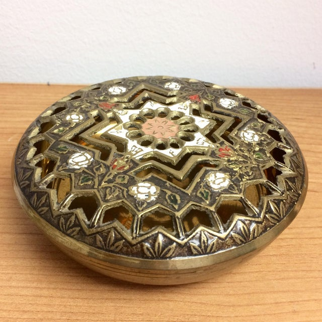 Pink, white red and green enamel on a pierced and patterned brass lidded box. Use it for jewelry, as a diffuser for...