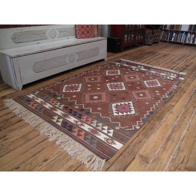 A high quality village Kilim from NW Turkey with an unusual color palette. In excellent condition.