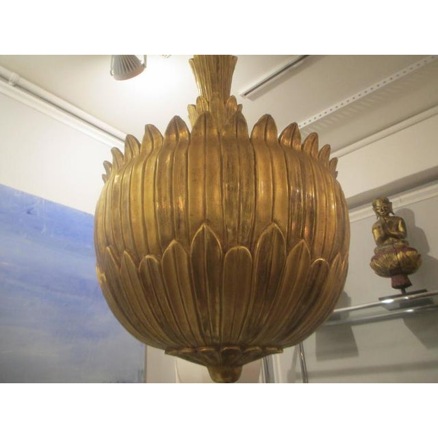 Unusual giltwood hand-carved fixture.