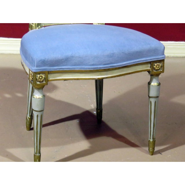 Antique distressed painted Louis XV sytle side chair with a painted scene on the back.