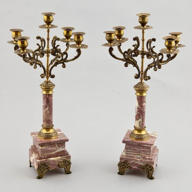 Pair of late 19th century French candlesticks have a base of purple and white veined marble, brass feet, fittings and five...