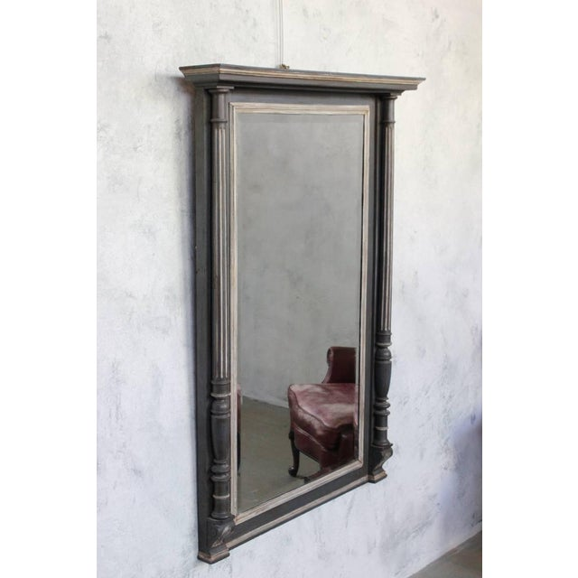 French 19th century carved wooden mantel mirror with columns and cornice painted in grey and white with beveled mirror.