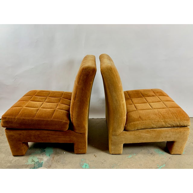 A pair of fully upholstered slipper chairs designed by Milo Baughman for Thayer Coggin.