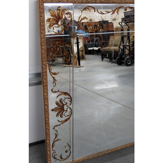 Mid 20th Century Regency style eglomise mirror with a distressed gilt frame.