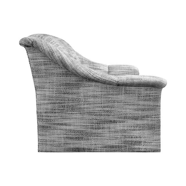 Modernist lounge chair in black and white wool basketweave upholstery. USA, 1970s.