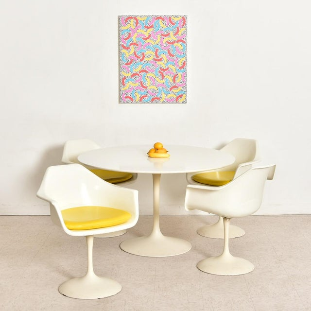 Designed by Eero Saarinen and produced by Knoll, this vintage iconic dining set is a sight to see. The bases are said to...
