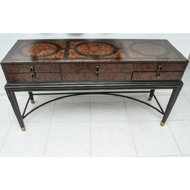 Stylish sideboard or console table by Maitland-Smith with brass hardware. It is signed.