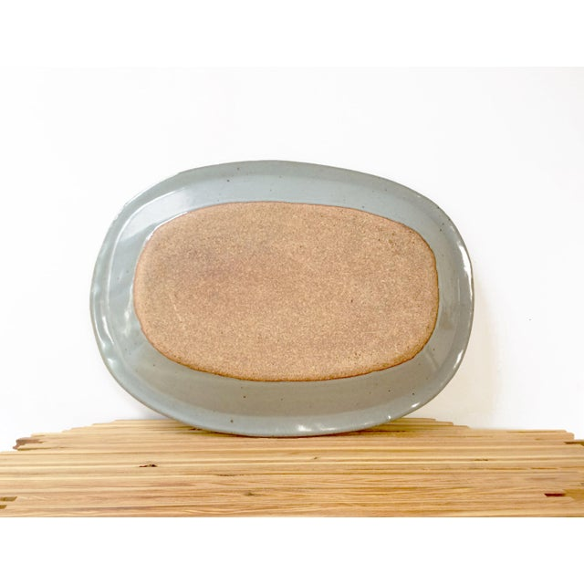 This is a wonderful glazed pottery platter with modern abstract painted geometric pattern. This heavy modernist platter...