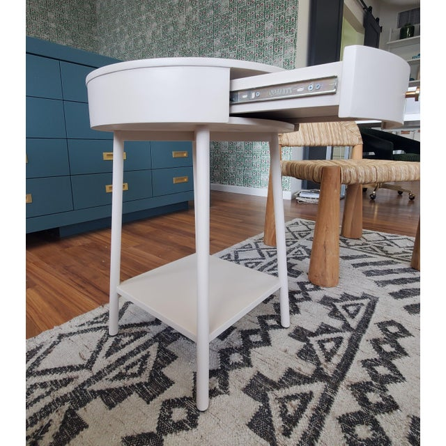Clean and simple nightstand from Four Hands - the perfect addition to any bedroom! It has a slight chip in the paint on...