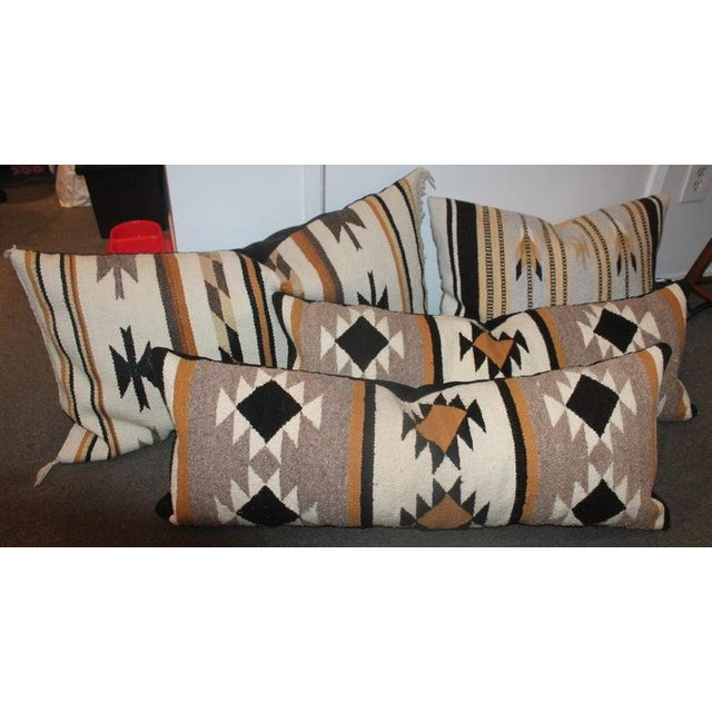 This collection of four Navajo Indian weaving pillows are in fine condition. All look so great together and we wanted to...