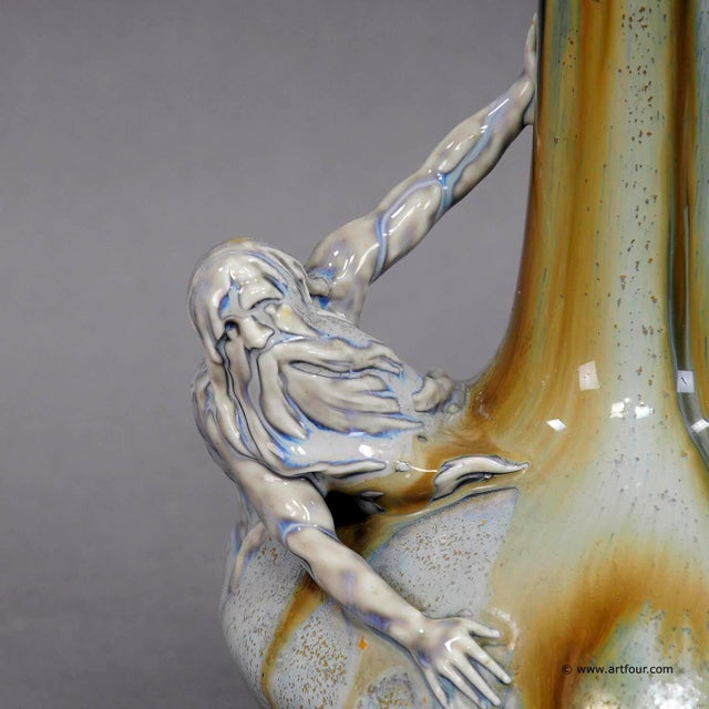 a nice antique porcellaine vase in typical art nouveau style. with a protruding neptun sculpture on the body. with blue...