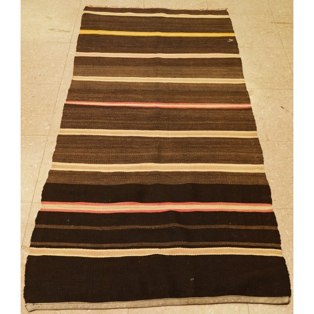 Vintage Turkish kilim hand made of soft hand spun wool with striped pattern.