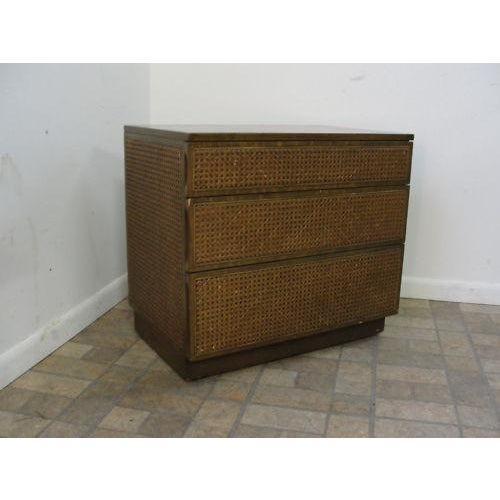 An Edward Wormley cane dresser. Very unique chest.. nice shape.. has some rub marks and scratches. Post-1950.