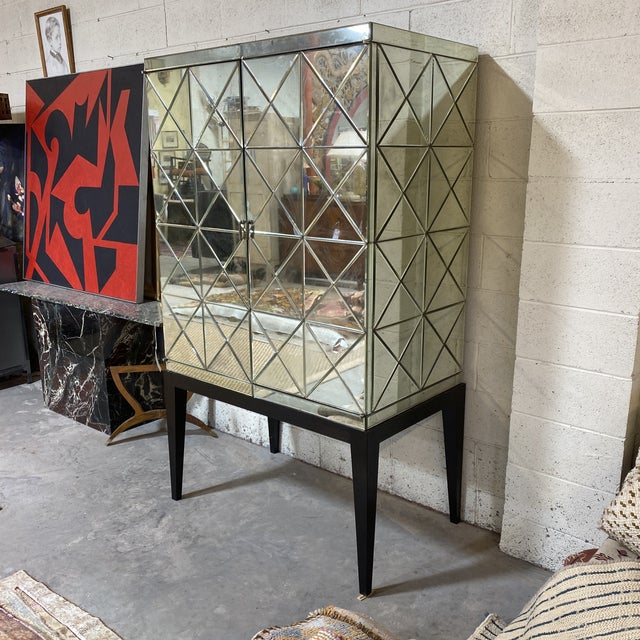 Gorgeous antiqued mirror cabinet ready for your home! The antique mirror and diamond Pattern make this a timeless piece....