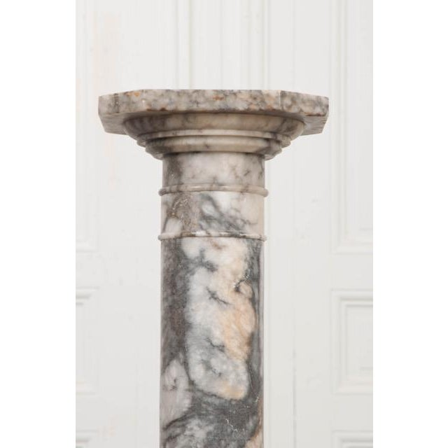 A beautifully veined French 19th century hand-carved grey-and-white marble pedestal, c.1870, in two parts, the chamfered...