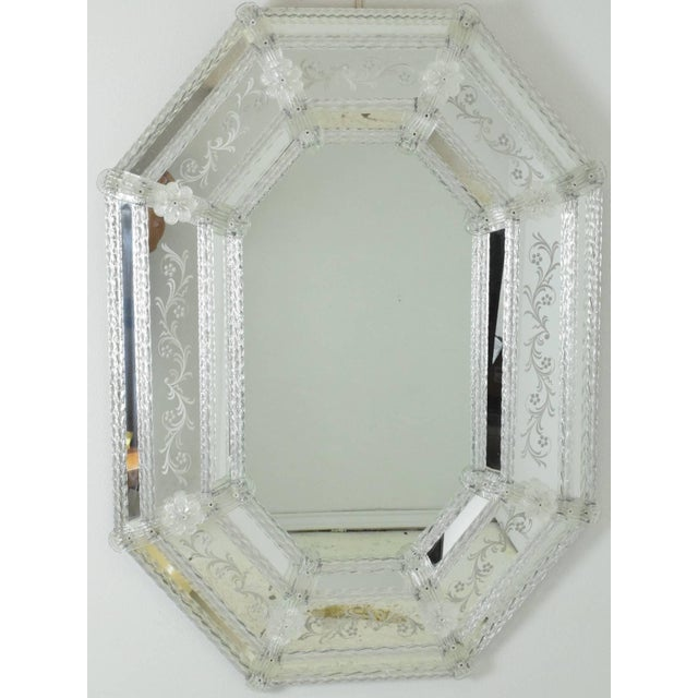 Stunning Venetian glass mirror with eight sides. Glass floral design, mirrored glass frames.