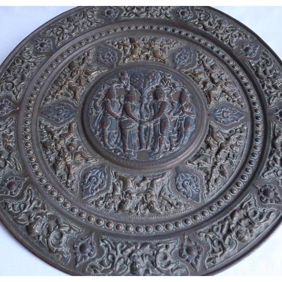 Late 19th Century Tanjore work plaque from South India. Brass, with sheet silver and copper on lac in relief. Circular...